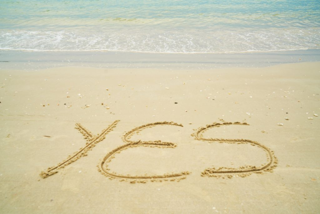 Yes written in the sand by the ocean